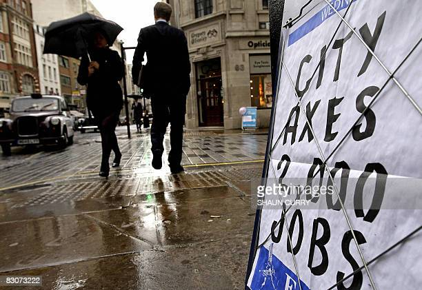 Board advertising newspaper headlines is pictured in London, on October 1, 2008. Britain's economy experienced zero growth in the second quarter...