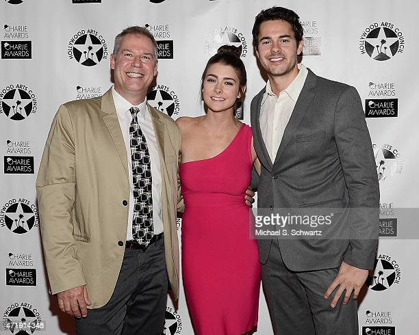 Board Chair of The Hollywood Arts Council David Warren actress Allison Paige and actor Jayson Blair pose during their attendance at the 29th Annual...