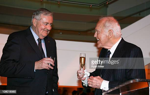 Board Chairman Thomas McKernan and Founding Chairman Henry Segerstrom raise a cheer at the Orange County Perfroming Arts Center's renaming ceremony...