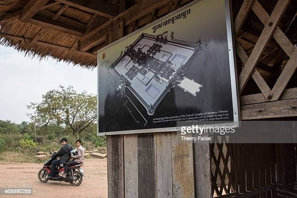 A board depicting an archeological reconstruction of the central complex of Banteay Chhmar temple is posted at the eastern entrance The temple built...