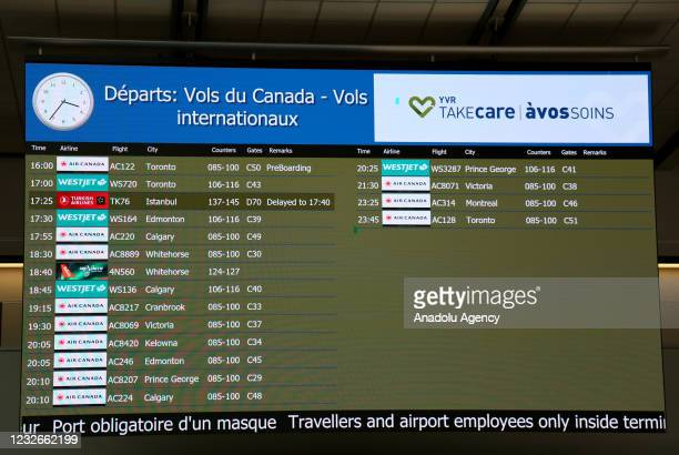 Board displaying flight information is seen at Vancouver International Airport in Vancouver, British Columbia, Canada on May 2021. Turkish Airlines'...