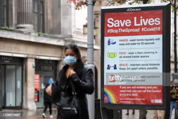 Board displaying information how to restrict the spread of coronavirus covid-19 is pictured in central Nottingham in central England on October 9,...