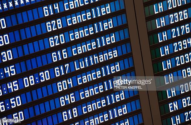 A board displaying informations on flights with many Lufthansa flights being cancelled can be seen at the airport in Munich southern Germany on...