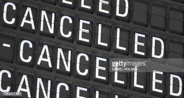 A board displays cancelled flights at the airport in Frankfurt am Main western Germany on January 15 2019 Hundreds of flights were cancelled at eight...