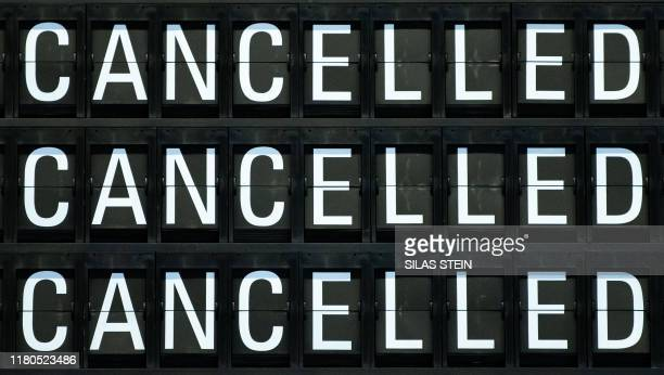 Board displays cancelled flights of German airline Lufthansa stand at the airport in Frankfurt am Main, western Germany, on November 7 as cabin crews...