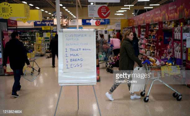 A board displays shopping restrictions at Tescos supermarket on March 19 2020 in Warrington United Kingdom After spates of panic buying cleared...