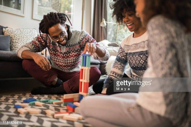 board games bring  family together - game night leisure activity stock pictures, royalty-free photos & images
