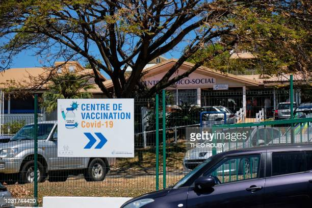 Board indicates the way to a Covid-19 vaccination centre of the French Social Protection Funds in Noumea, in the French remote Pacific territory of...