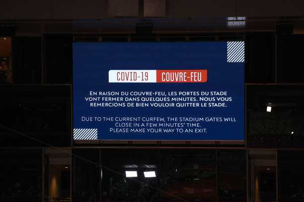 Board is displayed as play is suspended with fans being made to leave the stadium due to government curfew restrictions during the Mens Singles...