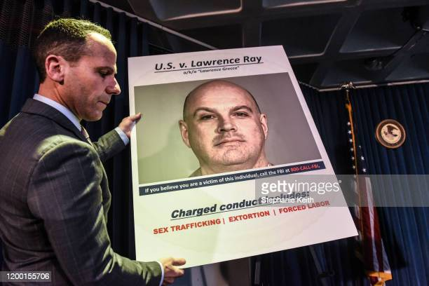 A board is placed before the United States Attorney for the Southern District of New York Geoffrey Berman announces the indictment against Lawrence...
