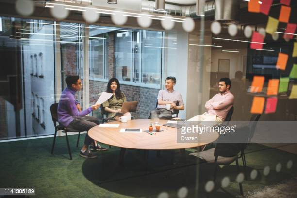 board meeting in millennial business. - employee engagement stock pictures, royalty-free photos & images