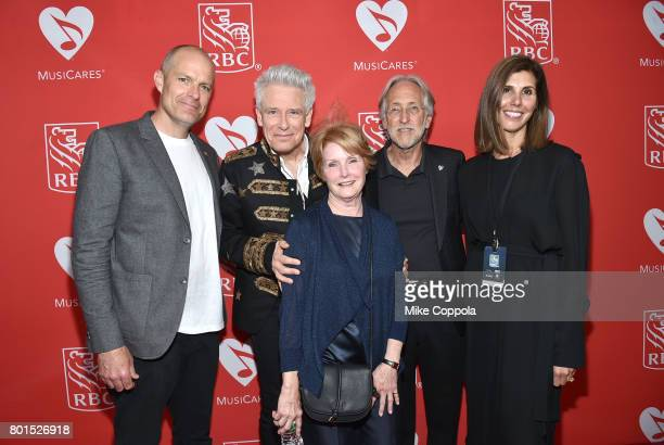 Board Member Michael McDonald Honoree Adam Clayton of U2 VP of MusiCares Dana Tomarken President/CEO of The Recording Academy and MusicCares Neil...
