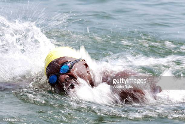 Board Member Mouhamedou Diop of Senegal competes in the Men's 5054 Age Group 3km swim during the 15th FINA World Masters Championships at Parc...