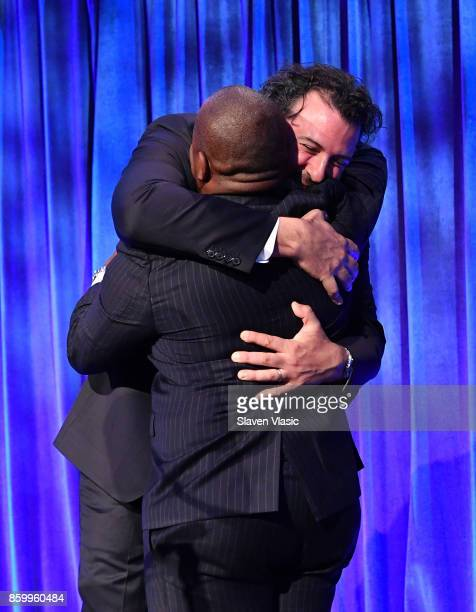 Board Member of Austism Speaks Billy Mann embraces Lawrence Brownlee onstage at Autism Speaks Celebrity Chef Gala on Wall Street at Cipriani Wall...