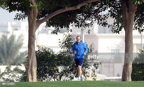 Board member Peter Peters of Schalke 04 runs next to the training session at day 3 of the Bayern Muenchen training camp at ASPIRE Academy for Sports...