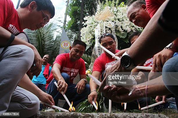 Board members of National Press Club lights a candle to commemorate the 6th Anniversary of Ampatuan Massacre Nov 23 2009 in Maguindanao They are also...