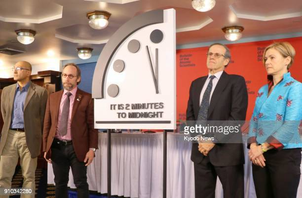 Board members of the magazine Bulletin of the Atomic Scientists present a panel in Washington on Jan 25 showing the minute hand on the symbolic...
