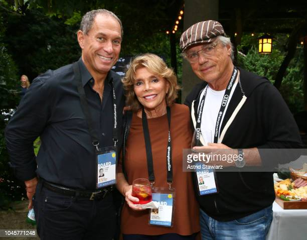 Board members Stuart Suna Judy Licht and Joseph Zicherman attend the Reception for Alan Alda at Baker House on October 4 2018 in East Hampton New York