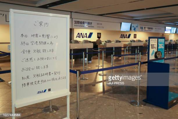 A board next to the All Nippon Airways checkin desks announces the cancellation of all flights due to an earthquake at Chitose airport in Chitose...