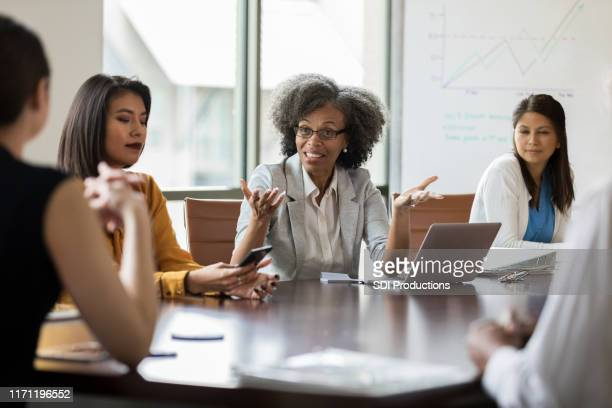 board of directors making decisions - american influenced stock photos and pictures