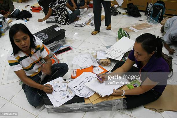 Board of Election inspectors work at the old provincial capitol of Maguindanao as vote counting continues to try to determine the next President of...