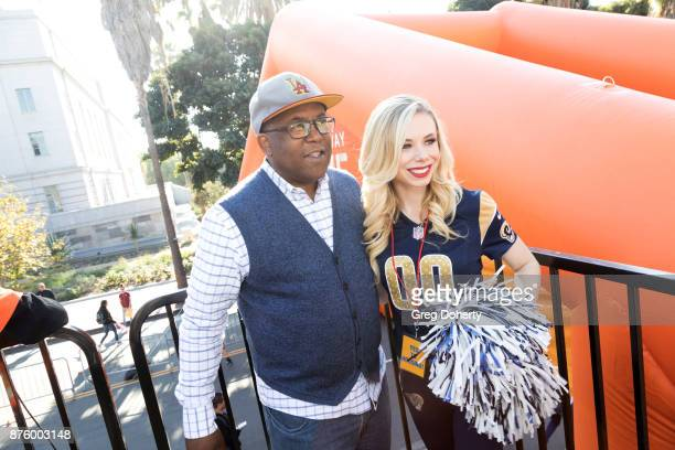 Board of Supervisors Chairman Mark RidleyThomas poses for a picture with LA Rams Cheerleader Brittany at the United Way Celebrates 11th Annual...