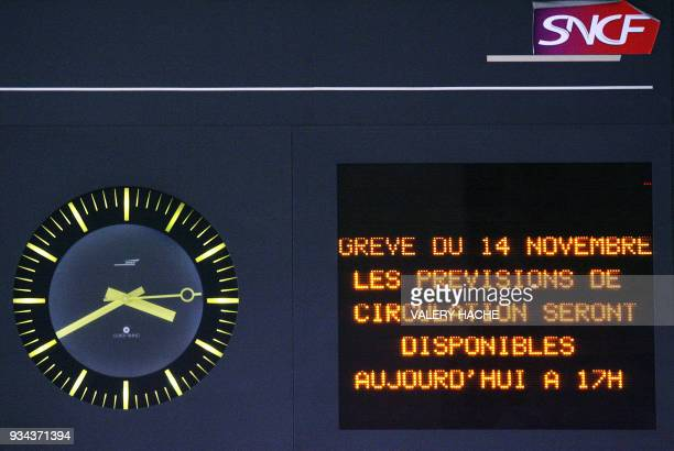 A board of the staterun SNCF railway company reading '14 November's strike a transport forecast will be availble today at 5 pm' is seen 12 November...