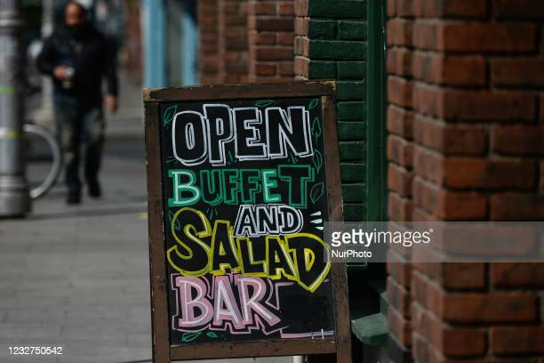 Board 'Open Bar Buffet And Salad' seen in front of a bar in Dublin city center during the final days of the COVID-19 lockdown. On Friday, 7 May 2021,...