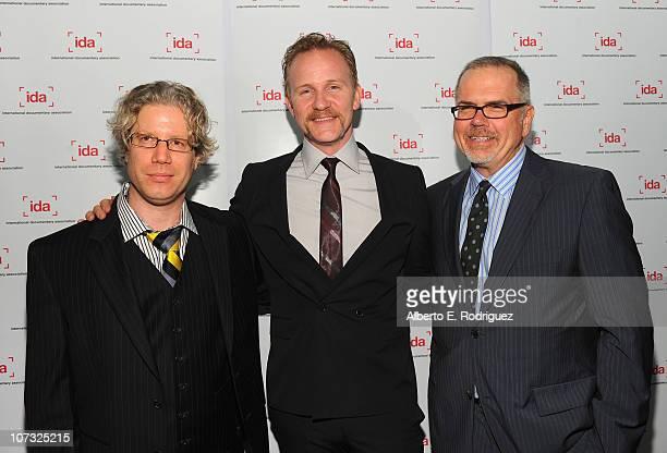 IDA board president Eddie Schmidt host Morgan Spurlock and IDA executive director Micheal Lumpkin arrive at the International Documentary...