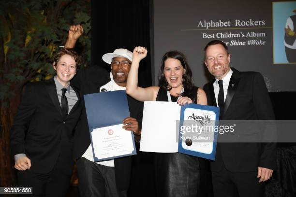 Board President Piper Payne and Executive Director of the Recording Academy San Francisco Chapter Michael Winger present Alphabet Rockers with...