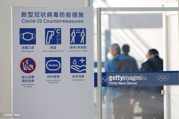 Board prompting COVID-19 countermeasures is seen in the National Speed Skating Oval on day one of the Speed Skating China Open, a test event of the...