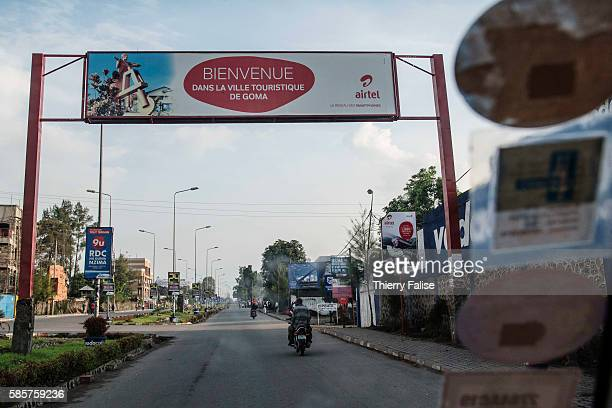 A board reading in French Bienvenue dans la ville touristique de Goma is erected at a city's entrance Goma is a 15 million people town and the main...