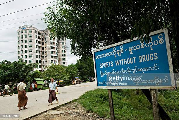 """Board reading """"sports without drugs"""" near apartment building in Hlaing Tha Yar, a so-called satellite town built some 20 kilometers from Rangoon.."""