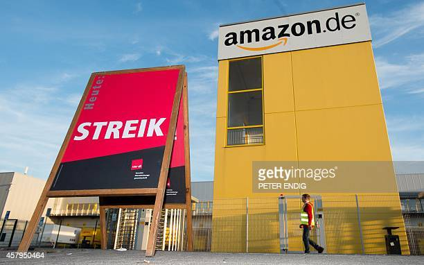 A board reading 'today strike' is displayed outside a centre of US online retail giant Amazon in Leipzig eastern Germany on October 27 2014 as five...
