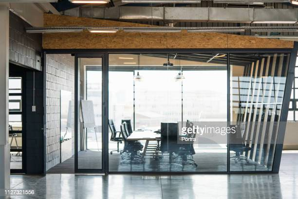 board room seen through glass in creative office - board room stock pictures, royalty-free photos & images