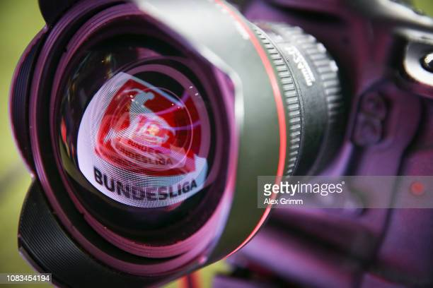 A LED board showing the Bundesliga logo is reflected in a lens prior to the Bundesliga match between Eintracht Frankfurt and Bayer 04 Leverkusen at...