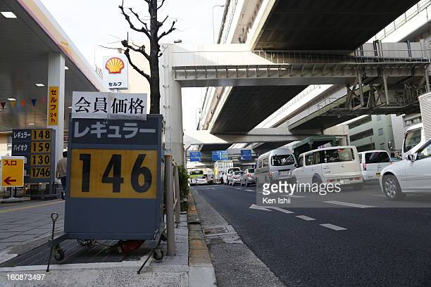 A board shows 146 Japanese yen per liter at a gas station on February 7 2013 in Tokyo Japan A recent servey shows Tokyo as the most expensive city in...