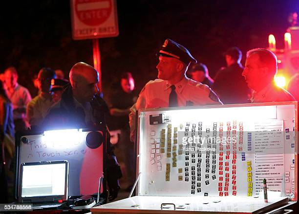 A board shows a list of emergency personnel that has gathered near the 79th St Boat Basin of the Hudson River into which a vintage World War II plane...