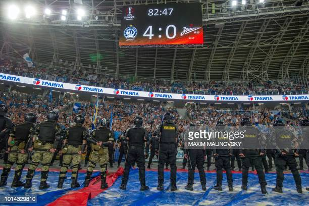 A board shows the 40 score minutes before the final whistle of the UEFA Europa League third qualifying round first leg football match between FC...