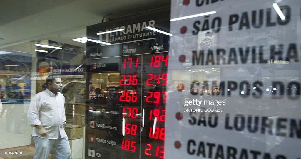 A Board With The Us Dollar To Brazilian Currency Real Rates At