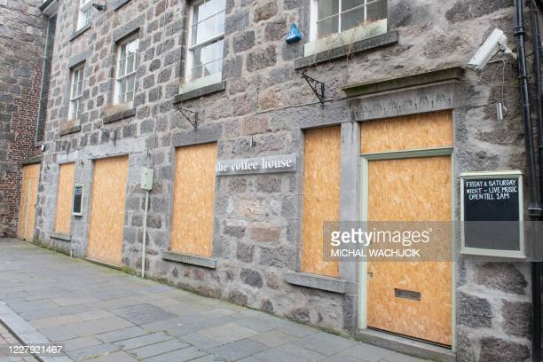 Boarded up coffee shop in Aberdeen, eastern Scotland on August 5 following the announcement that a local lockdown has been imposed on the city after...