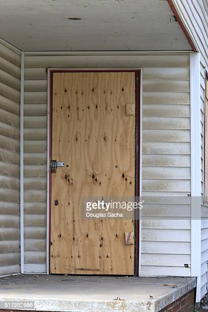 Boarded up door in an abandoned house