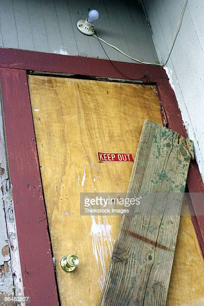 boarded up door - barricade stock pictures, royalty-free photos & images