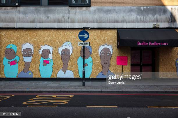 Boarded up East London night club on Curtain Road painted with mural to support NHS workers during the coronavirus pandemic on the 24th April 2020 in...