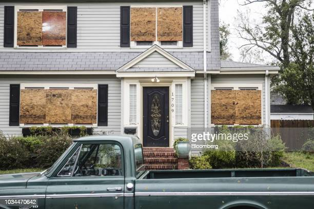 A boarded up home stands after Hurricane Florence hit in Wilmington North Carolina US on Saturday Sept 16 2018 In flooded communities emergency...