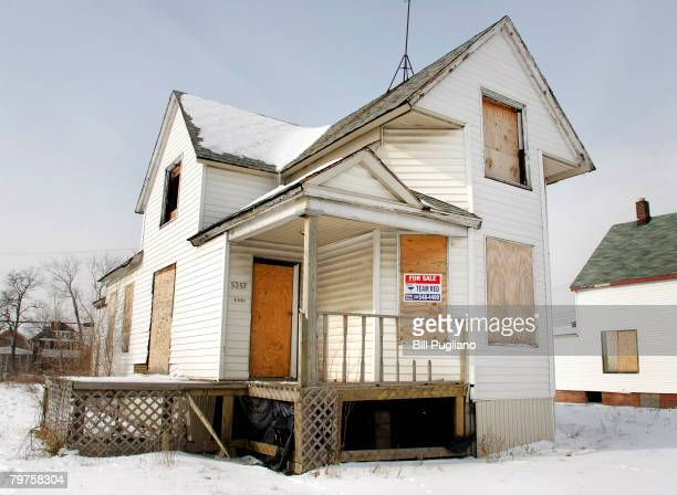 A boarded up house sits for sale February 14 2008 in Detroit Michigan The Detroit area hit hard by a combination of unemployment and a slumping...
