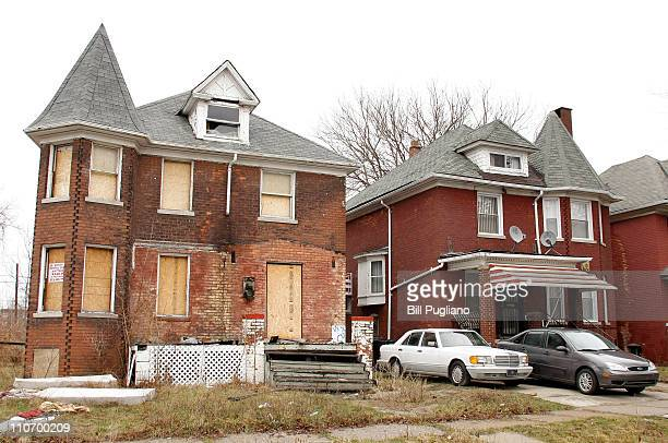 A boarded up house sits next to an occupied home in a Detroit neighborhood March 23 2011 in Detroit Michigan The new census figures show that Detroit...