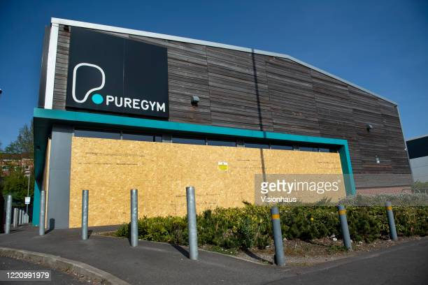 A boarded up Pure Gym health club closed due to Covid19 on April 23 2020 in Manchester England The British government has extended the lockdown...