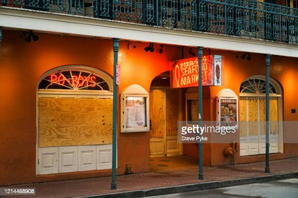 A boarded up seafood restaurant on Bourbon Street in the French Quarter of New Orleans amid restrictions in place to help deal with the Covid19...