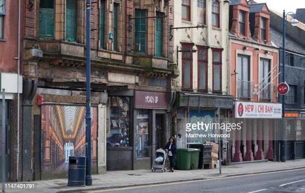 Boarded up shops and retail units on High Street on March 30 2019 in Swansea United Kingdom Large numbers of high street stores across the UK have...